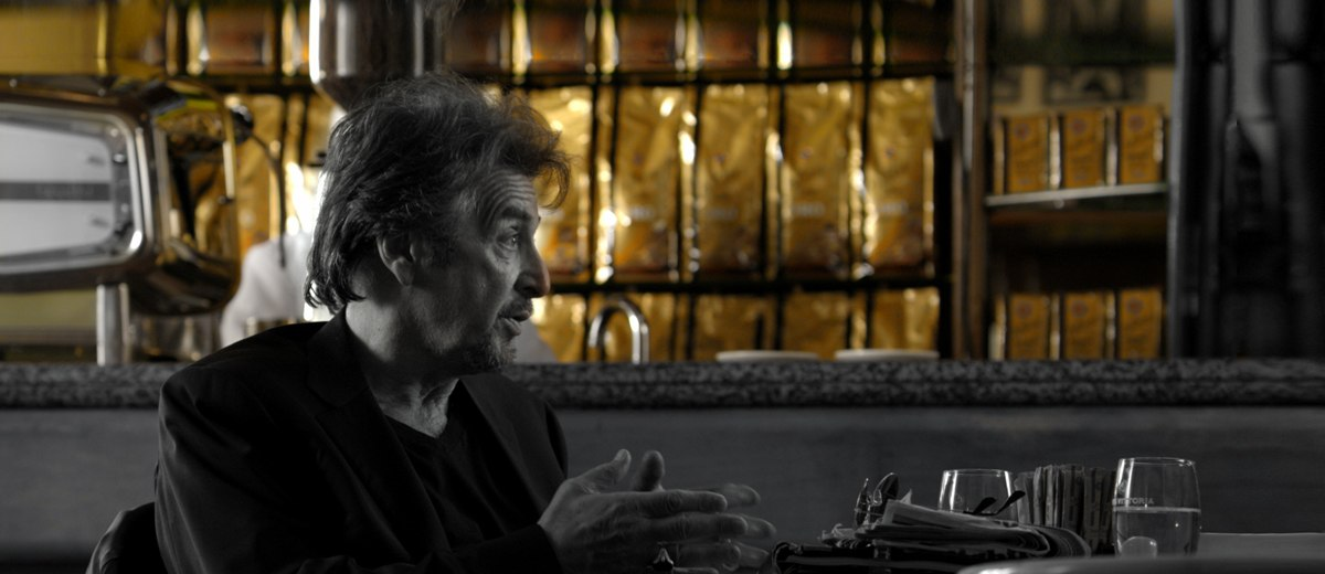 The face of Vittoria Coffee, Al Pacino sitting in a cafe drinking Vittoria Coffee