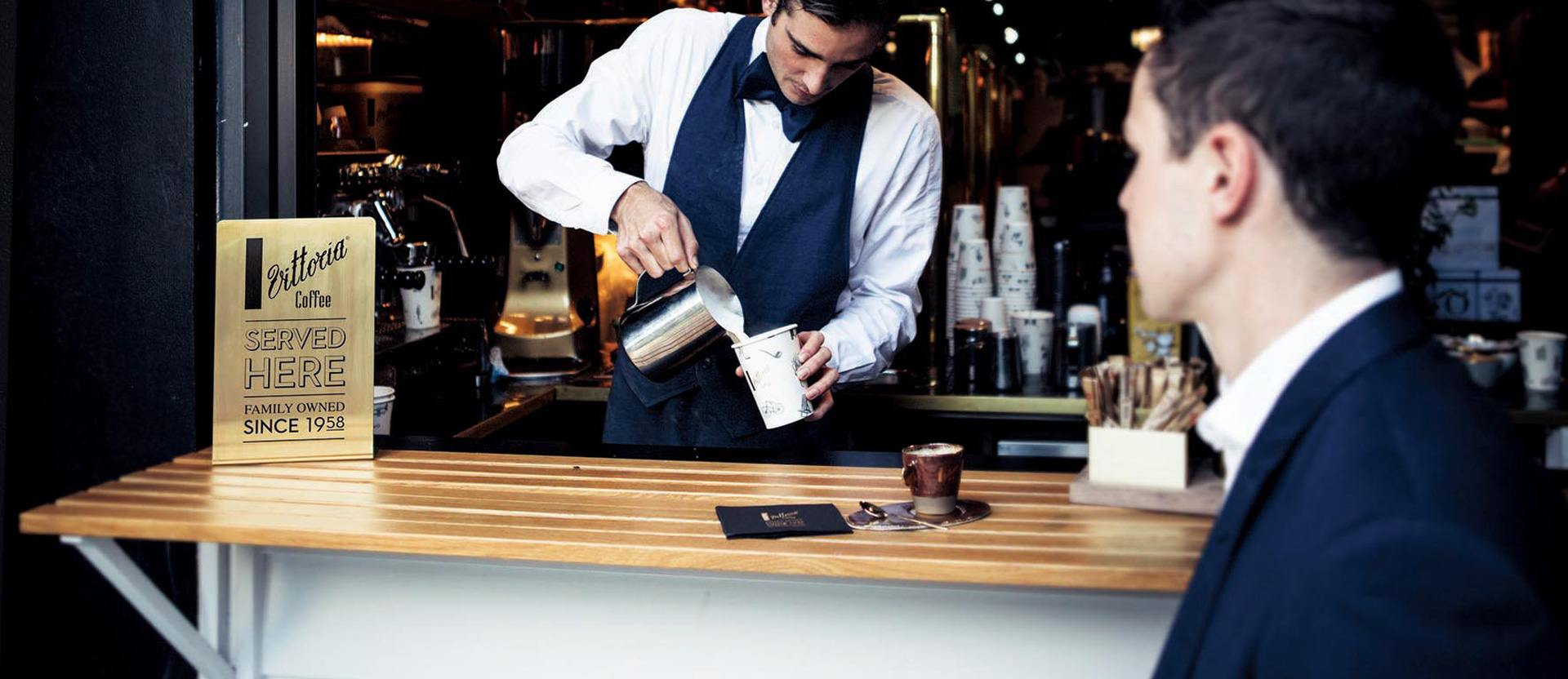 A Vittoria Coffee barista pours a coffee at L'Americano Espresso cafe