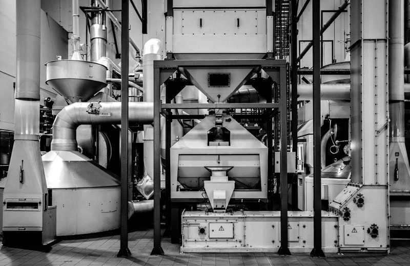 A collection of large Vittoria Coffee roasting machine in the factory