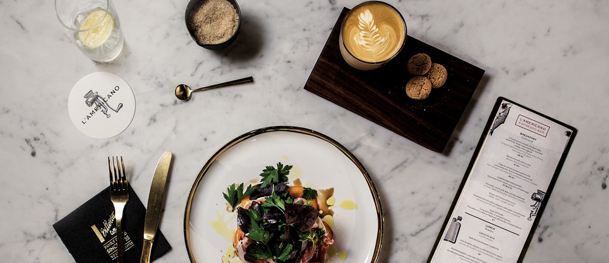 A beautifully presented meal accompanied by a freshly made Vittoria Coffee, served at Sydney local cafe, L'Americano Espresso