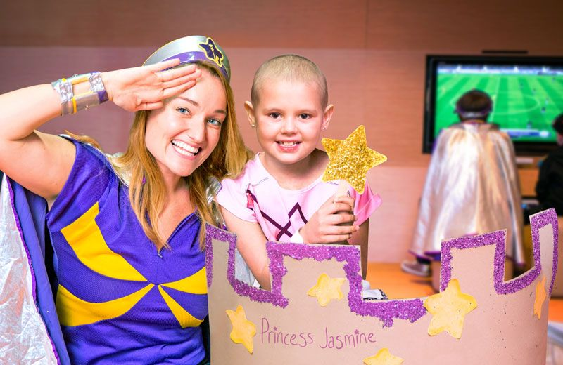 Captain Starlight playing princess games with a sick child