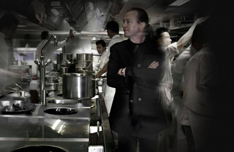 Vittoria Coffee collaborator, Neil Perry standing arms crossed in a busy kitchen