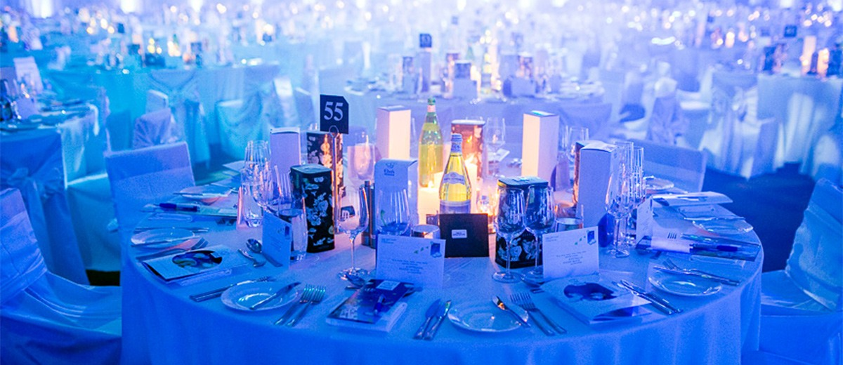 A table setup ready for the Starlight Foundation charity event with Vittoria Coffee Ellery tins
