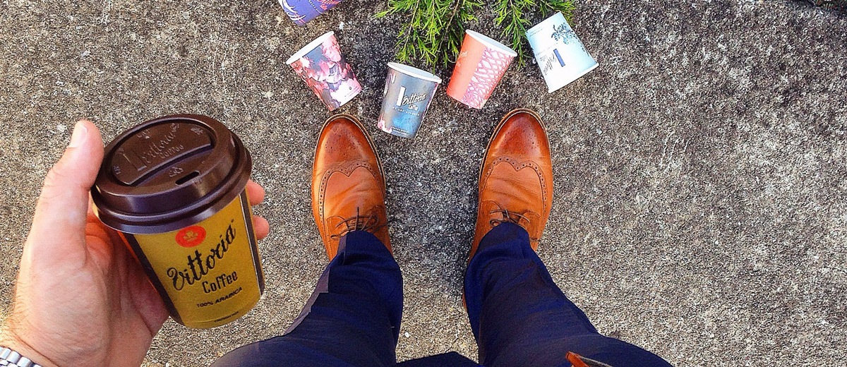 The View From Up Here holding a Vittoria Coffee with Vittoria Coffee Fashion Series cups scattered by his feet