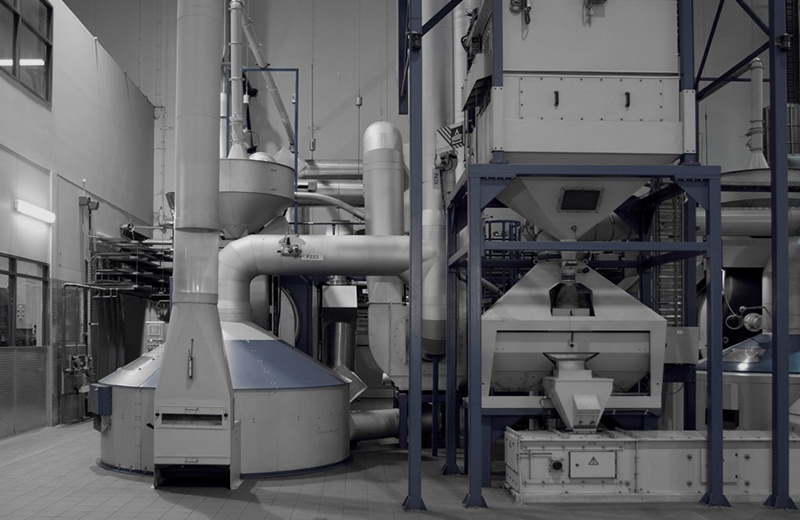 3 large coffee roasting machines together in a factory