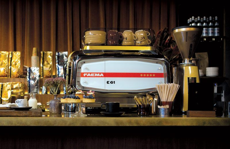 A Faema coffee machine surrounded by Vittoria Coffee products