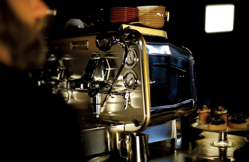 A close up of a Faema coffee machine