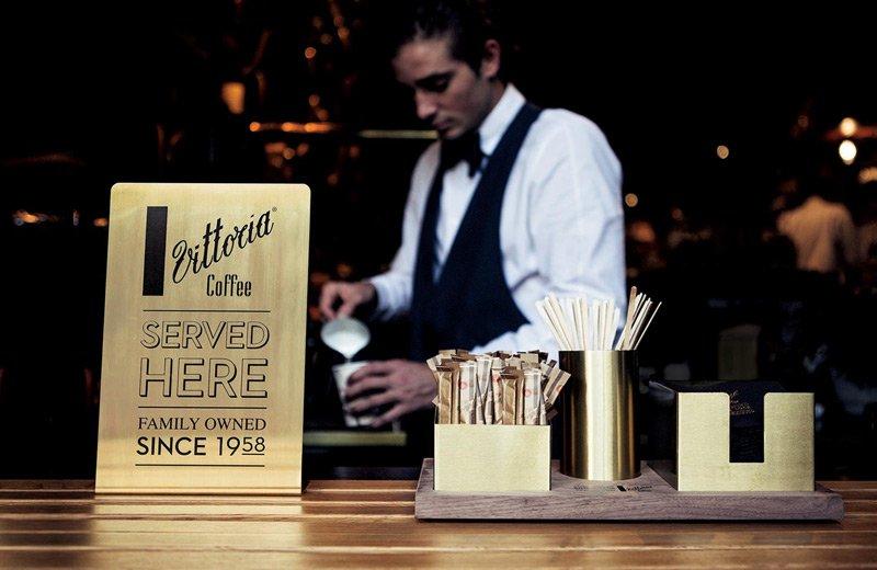"A gold plaque at L'Americano Espresso stating ""Vittoria Coffee served here"""