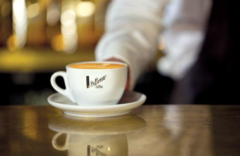 A freshly made Vittoria Coffee flat white coffee