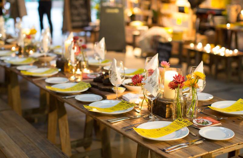 A long table setup for an OzHarvest charity event