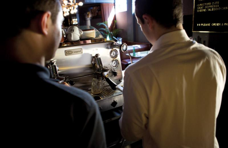 Looking over a technicains shoulder as he assists in servicing a Vittoria Coffee machine at the Golden Age cinema bar