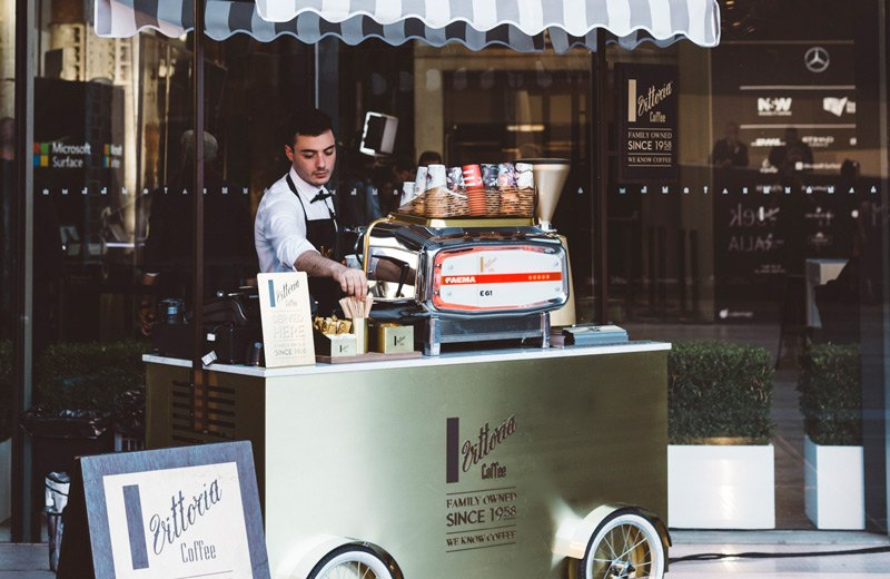 A Vittoria Coffee barista preparing at the coffee cart at MBFW